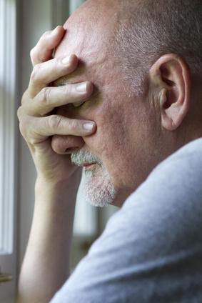 Older man expressing pain or depression, vertical
